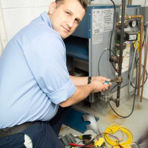 Technician fixing furnace